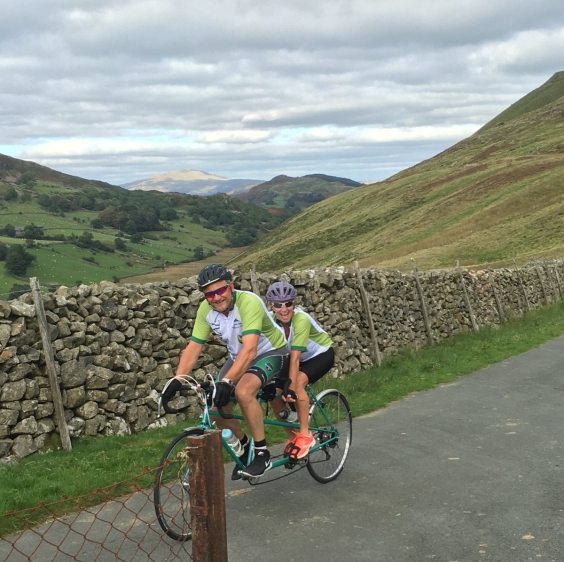 Mark and Louise cycling through Devon on the tandem.