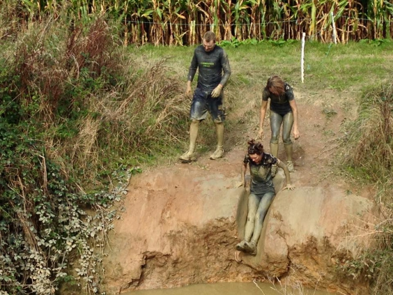 "Kate plunging into a ""ditch"" with team mates, Chris & Catherine."